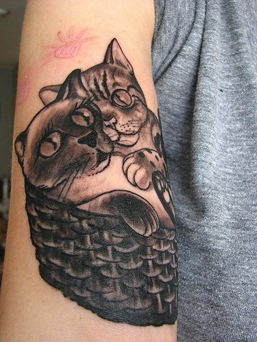 Two cats in basket black ink tattoo