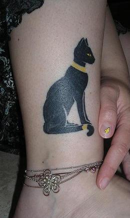 Egyptian cat in gold leg tattoo