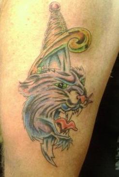 Cat head on dagger coloured tattoo