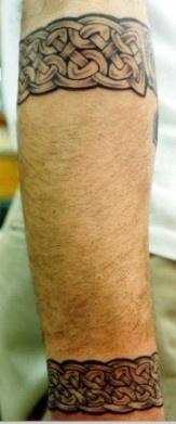 Celtic tracery armband tattoo