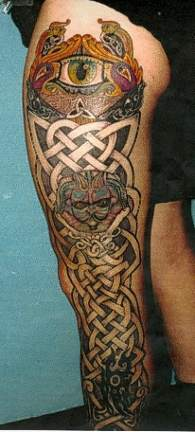 Full leg celtic style tattoo with eye beast and gnome