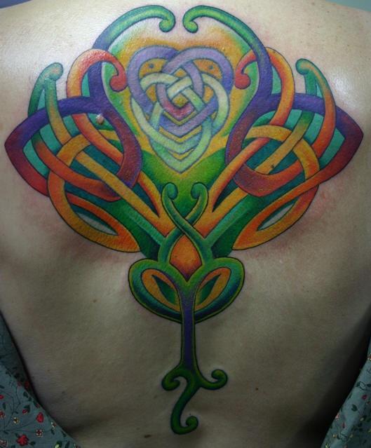 Celtic coloured tracery back tattoo