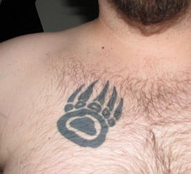 Bear paw print tattoo on chest