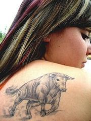 Realistic running bull on shoulder