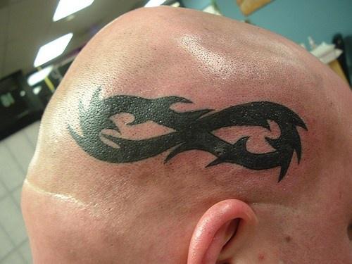 Tribal infinity symbol on head