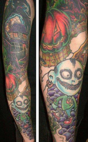 Coloured halloween themed sleeve tattoo