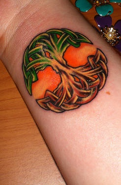 Celtic world tree coloured wrist tattoo