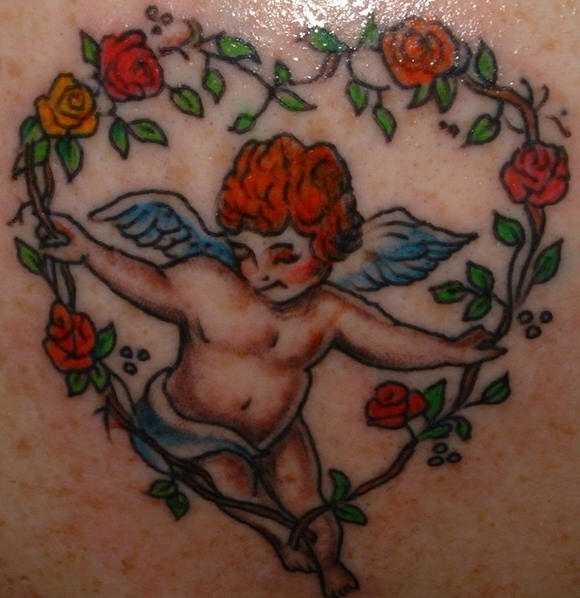 Colourful cherub in flower heart tattoo