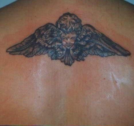 Cherub with angel wings tattoo