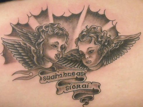 Two cherubs in clouds tattoo in black