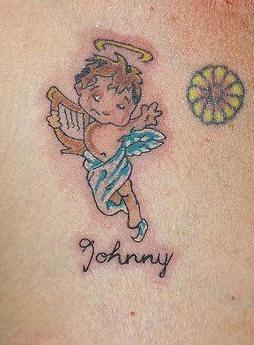 Baby angel chest tattoo