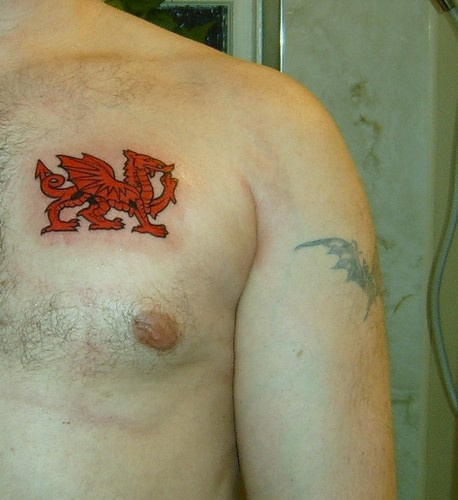 Red welsh dragon tattoo on chest
