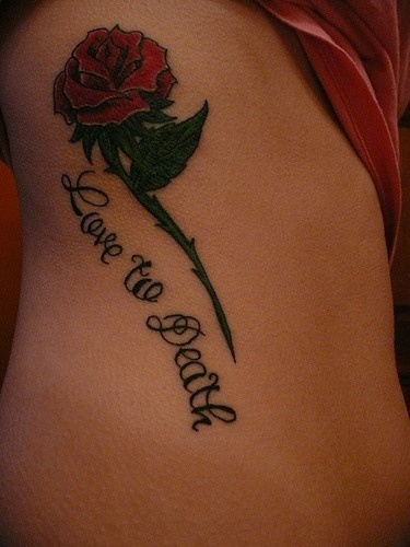 Red spiked rose love to death tattoo