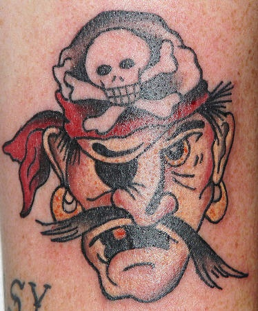 Small classic tattoo of pirate with one eye