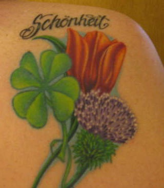Clover thistles and tulip coloured tattoo