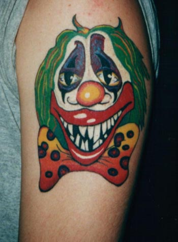 Colourful bad clown tattoo