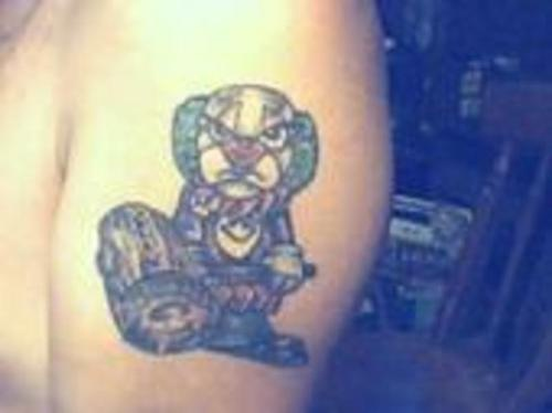 Angry clown with wooden hammer tattoo