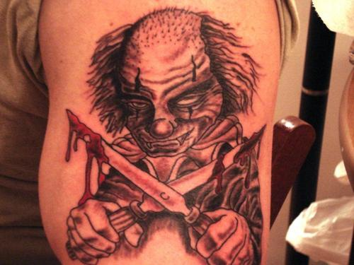 Crazy clown with knives  tattoo