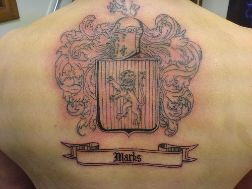 Coat of arms unfinished tattoo on back