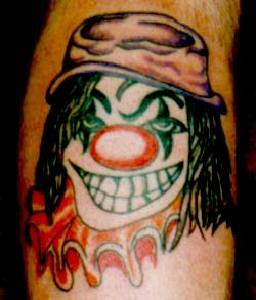Psycho clown in hat coloured tattoo