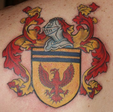 Heraldic shield with red hawk coloured tattoo