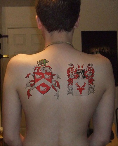 Red and white heraldic symbols on back
