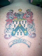 Heraldic shield emblem coloured tattoo