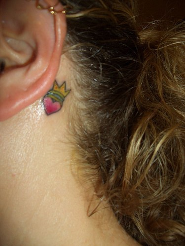 Small crowned heart tattoo behind the ear for Latin kings crown tattoo