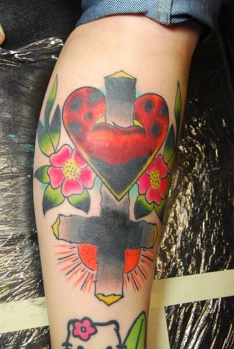 Upturned cross with heart and flowers in colour