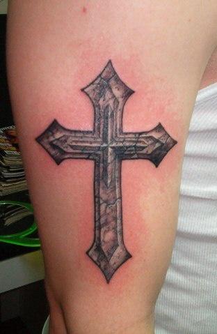 Classic stone cross tattoo