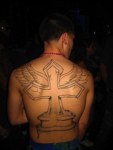 Winged cross tombstone tattoo on back