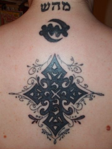 Patterned cross tattoo with hebrew writings