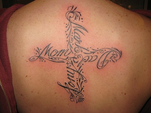 Cross made of name of relatives on back