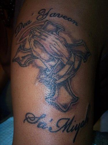 Cross with prayer hands tattoo