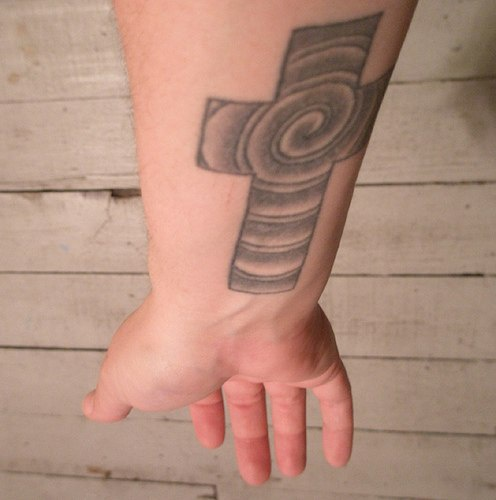 Cross with spiral in it tattoo