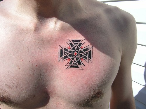 Maltese cross trasery tattoo on chest