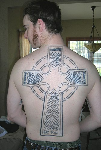 Large tombstone cross tattoo on back