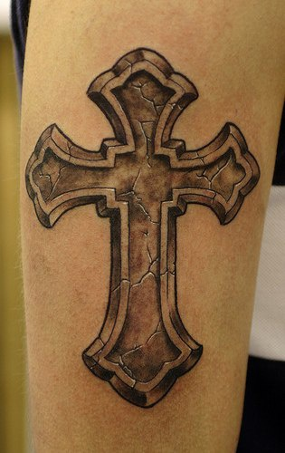 Realistic stone cross tattoo