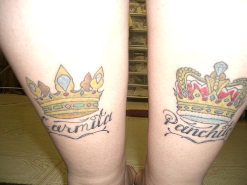 Two crowns tattoos on both legs