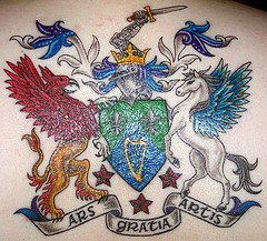 Heraldic symbol with pegasus and gryphon tattoo