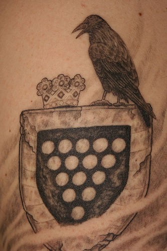 Heraldic shield with crow and crown