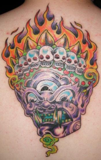 Three eyed demon with crown of skulls tattoo