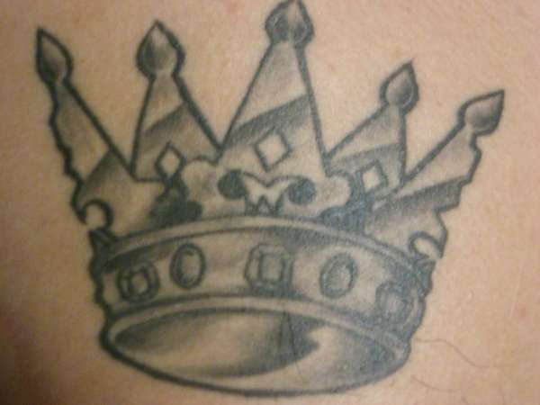 Golden crown black ink tattoo