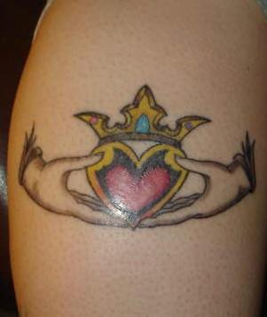 Claddagh ring coloured symbol tattoo