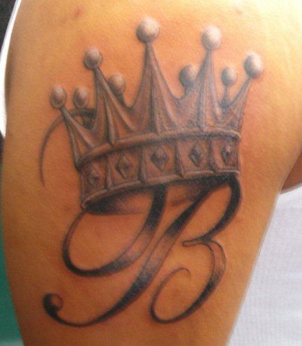Crowned monogram tattoo