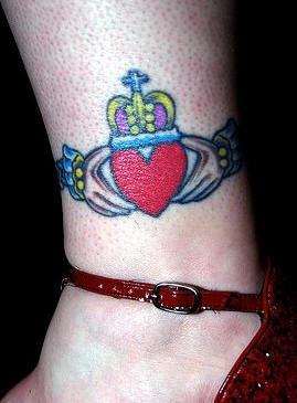 Claddagh ring symbol on shaved  leg