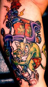 Green demon with clover tattoo