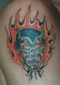 Red devil in flames tattoo