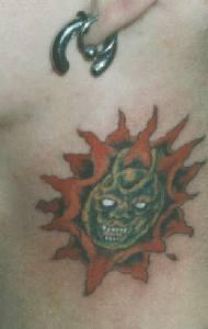 Small sun demon tattoo on neck