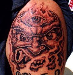 Three eyed demon tattoo